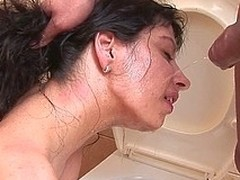 Sexually excited pissing wench kinked up on the shitter