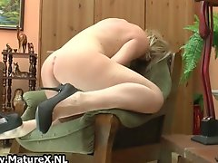Immodest housewife fucking her own taut love tunnel
