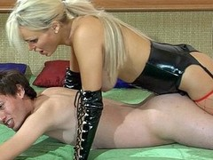 Perverted blonde mistresse in leather gear plugs her sub