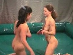 Stripped gals wrestling