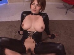 Spoils plus breasty Oriental doll in the matter of leather dress rides a large one