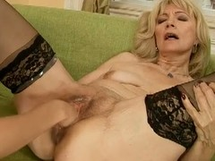 Golden-haired older receives fisted and dildoed with a atypical