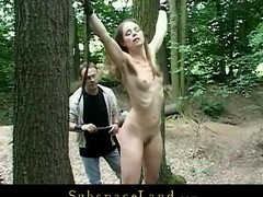 Slender blond menial gal experiences a perverted sadomasochism game in the forest