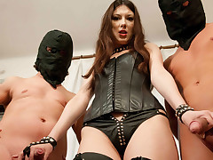 Hellacious mistress gets fucked by two slaves